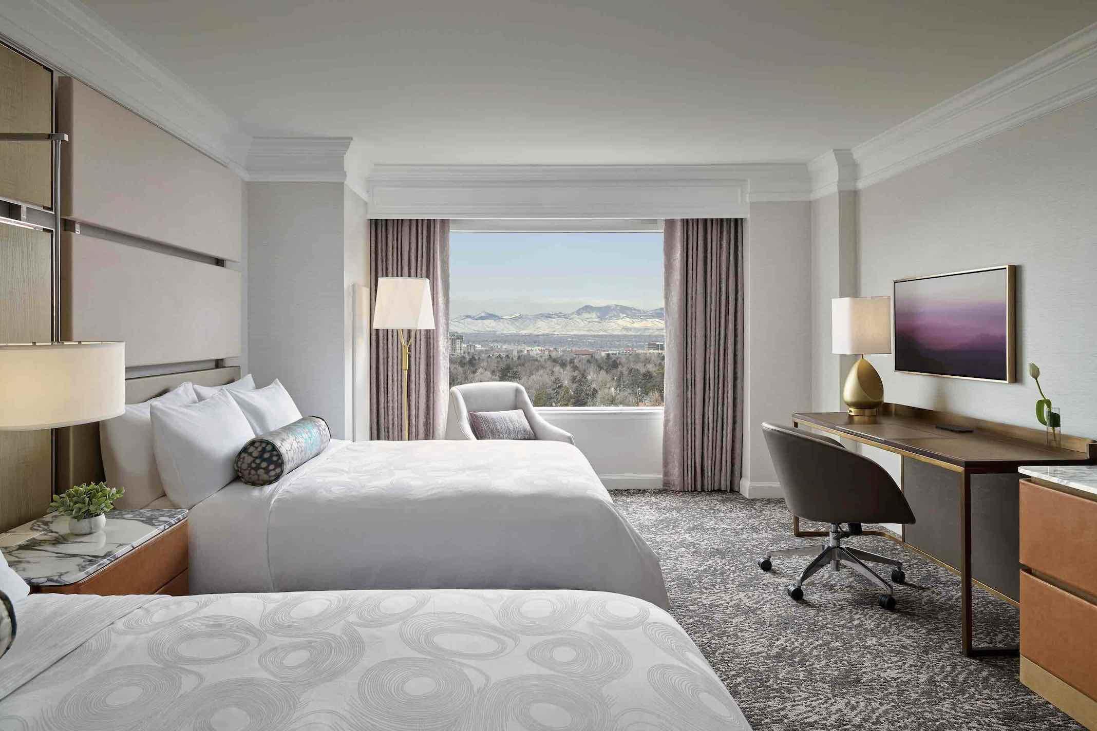 JW Marriott Denver Cherry Creek bedroom view toward Rocky Mountains